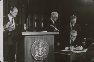 Gov Rockefeller signs the APA Private Land Use Plan legislation. Richard W. Lawrence, first APA Chair, looks on at left. Photo by Paul Schaefer.