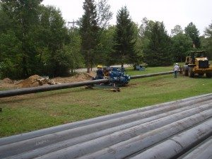 Crews installing snowmaking pipe at Titus Mountain