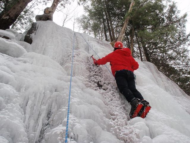 Dan Plumley climbs a route at Dipper Brook. Photo by Phil Brown.