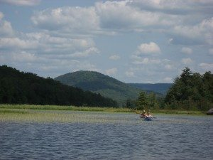 Paddling downstream of Canada Lake, with Kane Mountain framed in the background