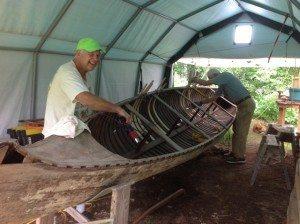Caleb Davis and Mason Smith working on War Canoe