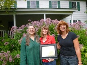 Hilary Smith (center) received the Hamilton County Soil and Water Conservation District's 2014 Partnership Appreciation Award from Manager Elizabeth Mangle (left) and Educator Caitlin Stewart (right).