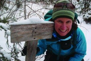 Carol Fox at Lake Andrew Sign by Phil Brown