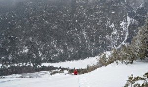 Dan Plumley climbing, Avalanche Lake below.