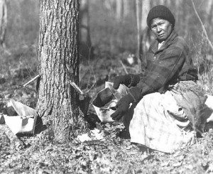 Native Woman collecting sap