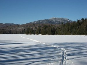 skiing on Newcomb Lake beyond the camp