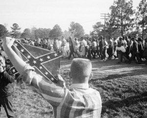 21 Mar 1965, Selma, Alabama, USA --- White Youth Holding Confederate Flag at March --- Image by © Bettmann/CORBIS