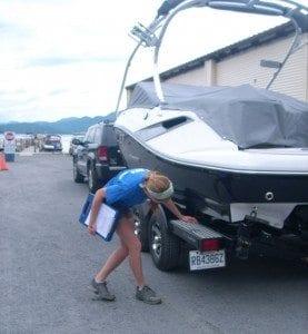 LGA Lake Steward Monika LaPlante inspects a boat in 2010 at the Norowal Marina