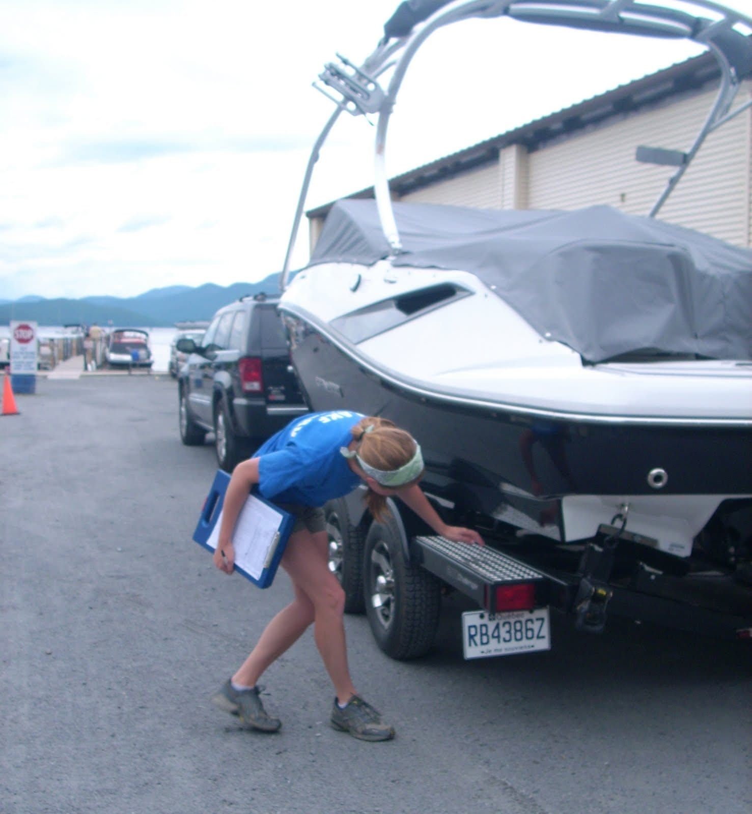 LGA Lake Steward Monika LaPlante inspects a boat in 2010 at the Norowal Marina