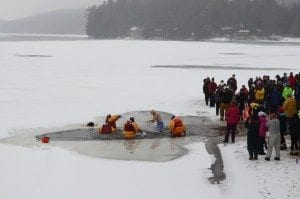 Long Lake residents and visitors take part in the annual Polar Bear Plunge at the town beach in Long Lake, NY.