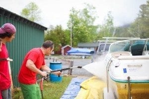 cleaning a boat by Veronica Spann