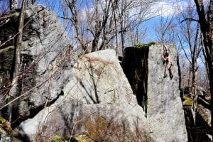 Photo by Tyler Hogan of climber on Tower of Power (V0) at Nine Corner Lake boulders