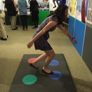 Museum Director Alison Haas demonstrates the Skate to the Beat activity