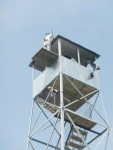 Photo of workers on the Stillwater Firetower