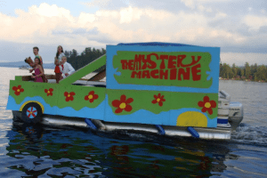 raquette lake boat parade mystery machine