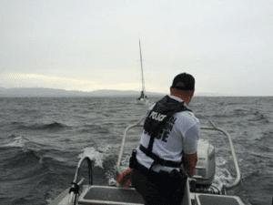 ECO Matt Dorrett adjusting the tow line to the Odinn on Lake Champlain