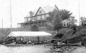 "The 1902 Clubhouse seen with club dock and the steamer ""Alice"""