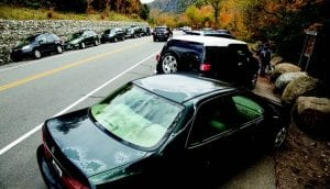 cars lining Route 73 by Mike Lynch