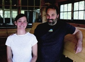 Allison Warner and Rob Davidson at their shop in Lake Clear