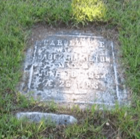headstone-disappearing-into-cemetery-soil