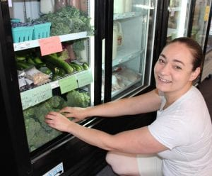 erin-kelley-manager-of-ticonderoga-natural-foods-co-op-stocks-the-shelves-with-local-produce