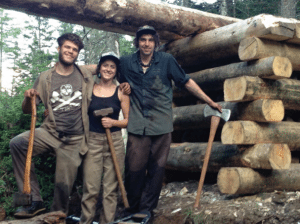 Dove Henry with trail crew members, building a bridge