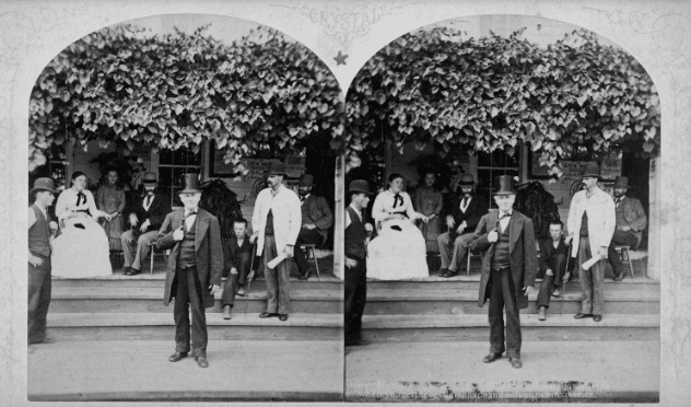 Travelers on the porch at the Halfway House, 1870.