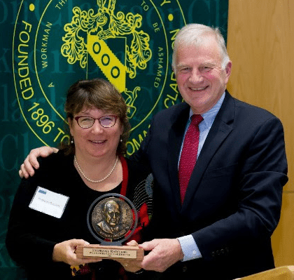 Clarkson President Tony Collins (right) presents the award to Ratcliffe