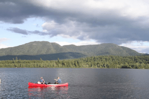 Paddlers make their way across Middle Saranac Lake