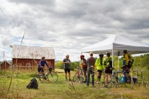 Bike the Barns participants take a break to taste local food snacks along the route in Essex
