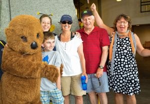 Ollie the Otter celebrates the millionth visitor Andrew Chrien, with Leah Valerio - Curator, Colleen Chrien, Charlie Wall and Stephanie Ratcliffe - Executive Director.