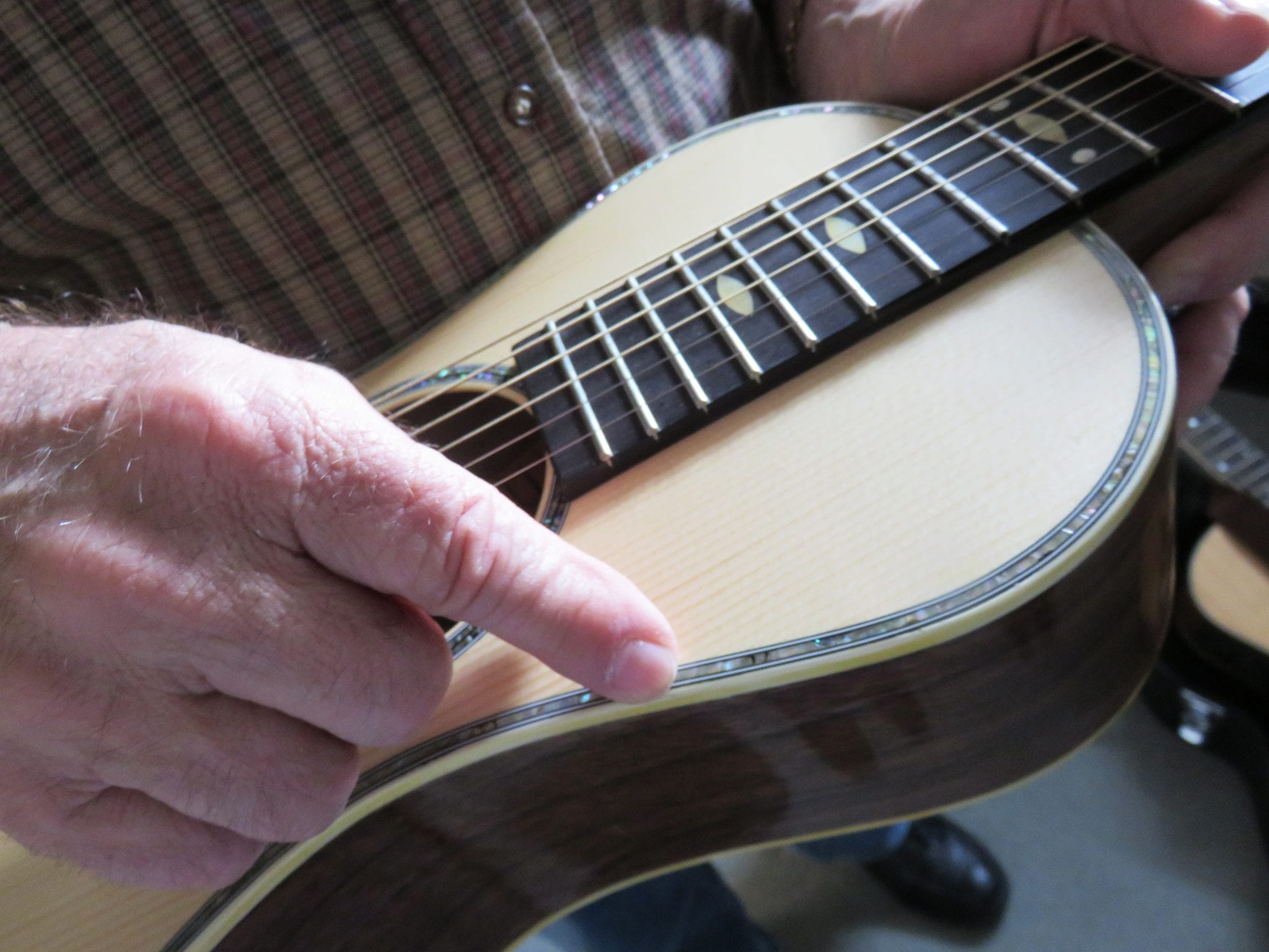 Dale Streeter of the Adirondack Playboys shows a guitar he made working with luthier Tracy Cox, 2016.
