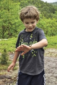 Gabe Heilman checks out a caterpillar on his wrist