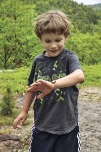 Gabe Heilman checks out a caterpillar on his wrist