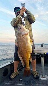 Jason Bair with the 36 lb drum he caught on Oneida Lake