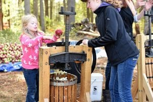 guest prepares fresh apple cider at the Adirondack Rural Skills and Homesteading Festival