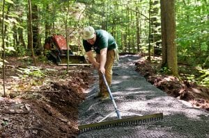 trail builder Ama Koenigsh on the first day Tahawus Trails LLC began work on the new universal access trail at the Conservancy's Boquet River Nature Preserve