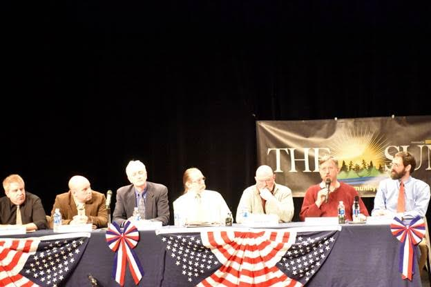 Pete Nelson of AWA, at right with microphone, answers a question during a Forum about Boreas Ponds in Schroon Lake