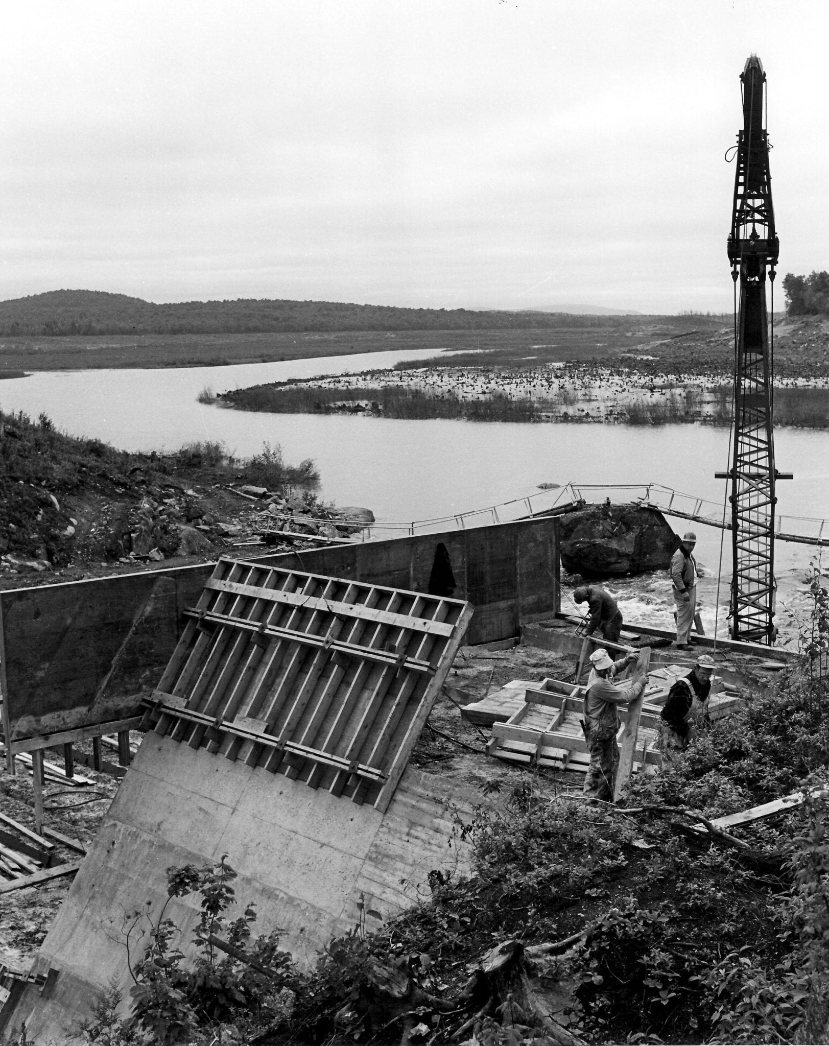 The view upriver from Carry Dam during construction, c. 1950s