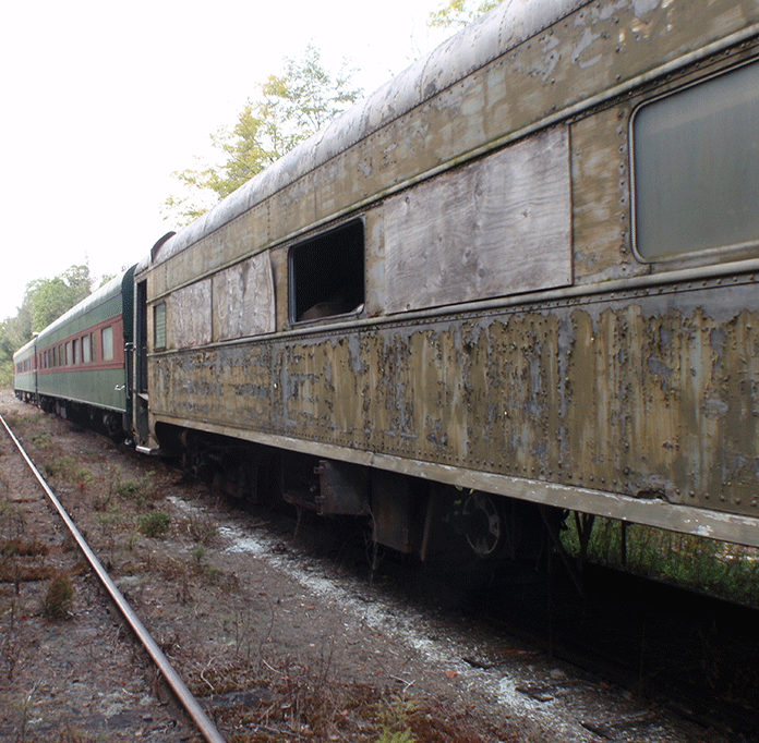 Railcars being stored on the Sanford Lake Railway in a section of railroad in the Vanderwhacker Wild Forest Area