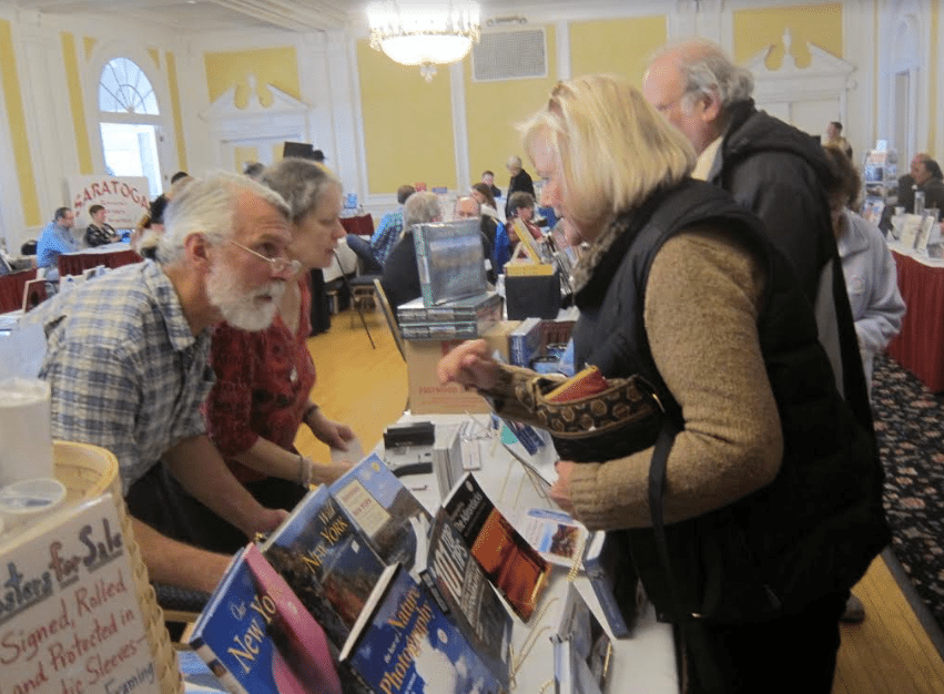 Carl Heilman, left, with customers at the 2016 Chronicle Book Fair