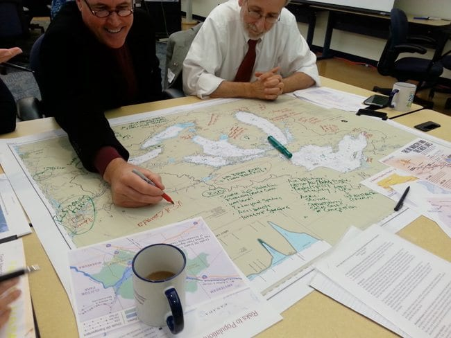 Workshop participants map out the issues around crude oil transport in the Great Lakes system. Photo: K.Bunting-Howarth, NYSG