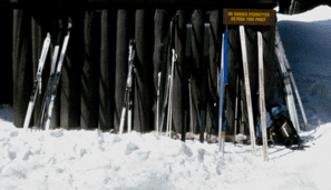 skis against camp santanoni main lodge