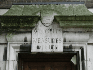 Sign of the former Weights and Measures office, Seven Sisters Road, London, England
