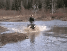 ATV user rides through a posted wetland in 2010