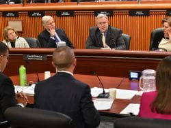 Assemblyman Dan Stec questions DEC commissioner about the proposed tax cap at a February 27 budget hearing in Albany. At left on the panel, Senator Betty Little.