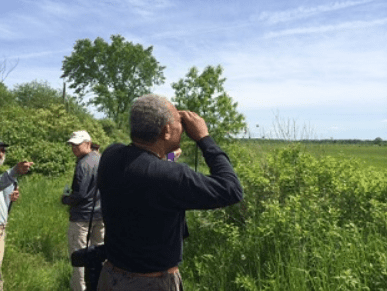 Birder at Washington County Grasslands provided by DEC