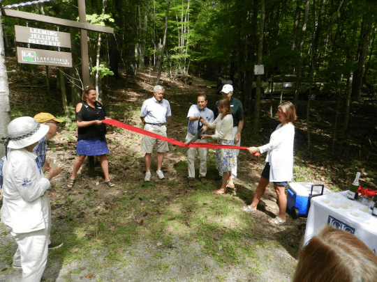 Cutting the ceremonial ribbon on September 7, marking the official opening of the Leeming Jelliffe Preserve