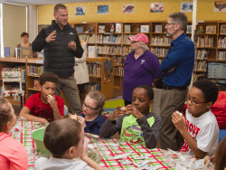 Kevin Richardson of Agbotic speaks with Starbuck Elementary School staff and students