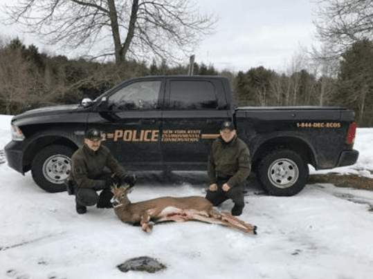 ECOs Pasciak and Manns with seized 6 point buck